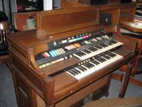 This a vintage Hammond Electronic Organ with Leslie