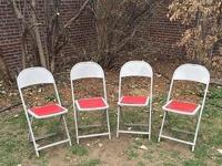 Set of four vintage gray metal folding chairs with red