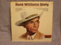 I HAVE A HANK WILLIAMS STORY L/P RECORD ALBUM. IT IS IN