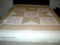"This classic homemade quilt measures 761/2"" x 79"". It"
