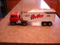 FOR SALE IS A VINTAGE HY-VEE TOY SEMI TRACTOR/TRAILER