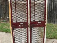 Double set of steel lockers with maroon front and white