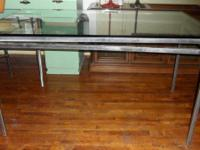 Classic steel table with geometric design base and