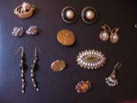 Various pieces of vintage jewelry. Some in perfect