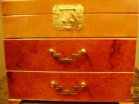 I have a vintage large wood jewelry box for