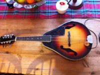 This is a beautiful Vintage Kent Mandolin in excellent