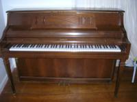 This is a vintage upright piano in great condition,