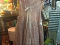 This vintage lace pink dress is cute and stylish. The