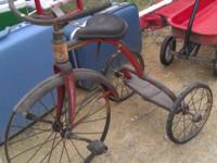 We have a Vintage Large Wheel Tricycle. It is in good