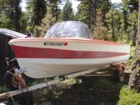 Vintage 63 Larson boat and trailer. The body is in good
