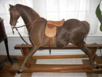 VINTAGE ROCKING/GLIDER EQUINE.  THIS EQUINE IS VERY