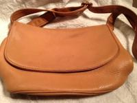 "Coach light caramel bag is 8"" by 13"". It has one flap"