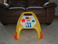 For sale is a vintage Little Tikes Activity Walker in