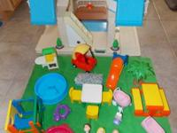 This is a nice vintage Little Tikes Dollhouse plus 23