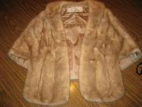 THIS MINK STOLE WAS PURCHASED AT BURTRUM FURS IN THE