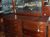 1940's dual serpentine front mahogany dresser with 6