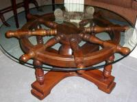 Available is a nice Mariner's wheel glass top coffee