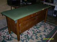 Vintage massage table for sale.very solid piece with 1