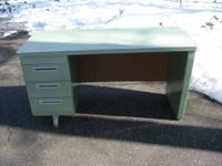 This vintage tanker desk is likely from the 1960s.