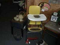 Here is a very cool vintage all metal highchair has