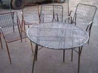 This is an old metal table and 5 patio chairs. They are