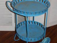 Antique metal cart in aqua blue. Wheels to move around