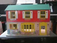 Antique metal doll house Is missing chimney Otherwise