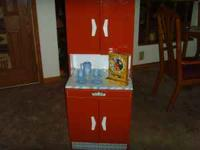 This Vintage Metal Child Toy Tin Kitchen Hutch from the