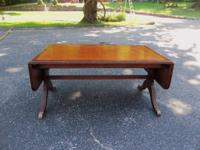 Drop leaf leather inlay coffee table.35 x 22 x 17.5""