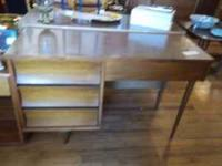 Beautiful Mid-Century Modern desk with four drawers. It
