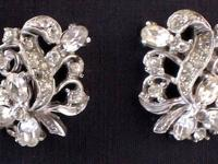 Pair of ornate rhinestone earrings with the rich,