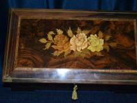This is a beautiful Burlwood with a rose inlay, velvet