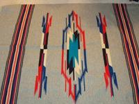 I have two vintage Navajo Chimayo wool blankets for