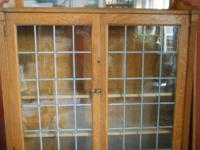 This is a classic oak bookcase, with leaded glass
