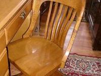 This is a beautiful old oak swivel chair and is in