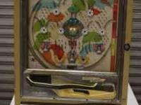 This is a 1970s vintage mechanical Pachinko machine in