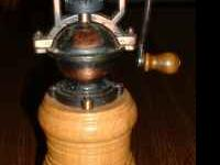 This vintage pepper mill/salt grinder measures about 8""