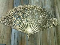 Very nice vintage plastic gold fan. This fan is great