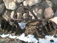 Several vintage farm tractor implements. Will sell