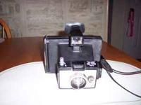1. Polaroid Square Shooter 2 - fair to good condition.