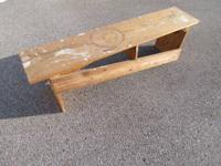 This is a homemade primitive style bench. Bench is old