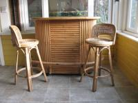 Rattan bar with formica top. The back side has shelves