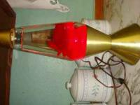 vintage red lava lamp with star light gold base Marvie