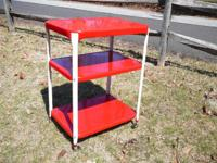 This colorful 1950s red and white wheeled metal CART