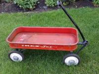 "Vintage Rex Jet red coaster wagon. Measures 15"" wide x"