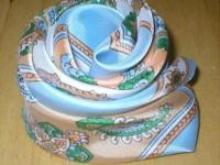 This vintage scarf, with a Paisley Design, has a light