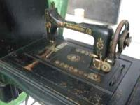 Vintage Sewing Machine in wood cabinet- $75 See pics to