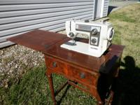 $90.00 THIS IS A VINTAGE SEWING MACHINE CABNET WITH A