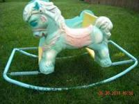 This is a lovely classic kid's rocking horse/bouncer