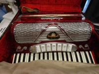 A VINTAGE SILVERTONE BLACK ACCORDION WITH ORIGINAL